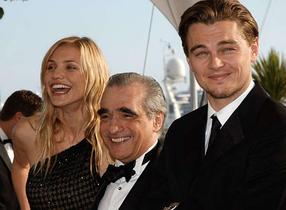 "American actors Leonardo diCaprio, right, Cameron Diaz, left, and American director Martin Scorsese, center pose after the screening of their film "" Gangs of New York,"" at the 55th International Film Festival in Cannes, southeastern France, Monday, May 20, 2002. Photo: CHRISTOPHE ENA, ASSOCIATED PRESS / AP2002"