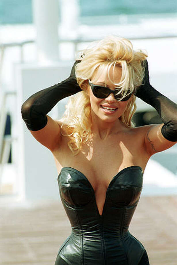 American television star Pamela Anderson poses on the French Riviera beach during the 48th Cannes International Film Festival in Cannes, France, Saturday, May 20, 1995. Photo: Remy De La Mauviniere, ASSOCIATED PRESS / AP1995