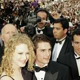 Actor Tom Cruise, center, arrives with Nicole Kidman, left, at the Cannes Film Festival Palace for the presentation of Ron Howards film Far and Away in which Cruise and Kidman star, at the 45th Cannes Film Festival, Monday, May 18, 1992, Cannes, France. Far and Away was out of competition and presented to close the 45th Cannes Film Festival.