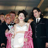 "American singer-actress Madonna leaves the screening of her movie ""In Bed with Madonna,"" known as ""Truth or Dare"" in the United States, with director Alek Keshishian, right, at the 44th Cannes Film Festival in France, May 14, 1991.  The documentary, filmed by the 26-year-old Harvard graduate, chronicles Madonna's 1990 ""Blond Ambition"" tour."
