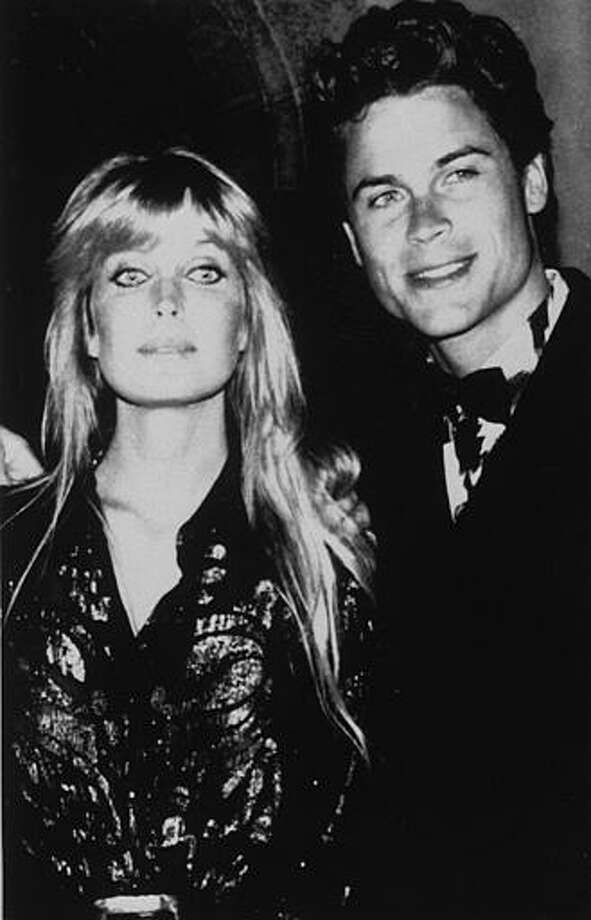 American actors Bo Derek, left, and Rob Lowe, appear together at a party in La Napoule near Cannes, May 16, 1989, during the 42nd International Film Festival. Photo: Anonymous, ASSOCIATED PRESS / AP1989