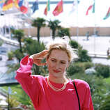 "American actress Meryl Streep puts her hair back as she poses on the terrace of the Festival Palace, during the Film Festival in Cannes, France, on May 13, 1989. Streep is promoting her recent picture ""A Cry in the Dark."""