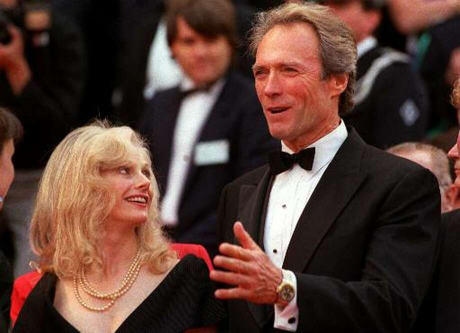 """Director-actor Clint Eastwood arrives May 21, 1988 with his then-girlfriend, actress Sondra Locke at the Cannes Palace for the screening of his film """"Bird"""" in competition for the 41st Cannes Film Festival, in Cannes, France. Photo: Gilbert Tourte, ASSOCIATED PRESS / AP1988"""