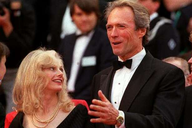 """Director-actor Clint Eastwood arrives May 21, 1988 with his then-girlfriend, actress Sondra Locke at the Cannes Palace for the screening of his film """"Bird"""" in competition for the 41st Cannes Film Festival, in Cannes, France."""