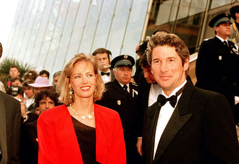 """American actor Richard Gere and French actress Gabrielle Lazure arrive for the screening of the American production """"Miles From Home,"""" at the 41th Cannes Film Festival in France, on May 18, 1988. Photo: Gilbert Tourte, ASSOCIATED PRESS / AP1988"""