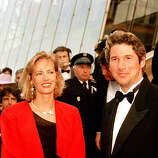"American actor Richard Gere and French actress Gabrielle Lazure arrive for the screening of the American production ""Miles From Home,"" at the 41th Cannes Film Festival in France, on May 18, 1988."
