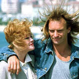 Sting, of the British band Police, and American actress Melanie Griffith pose at the 41st Cannes International Film Festival in Cannes, France, May 17, 1988.