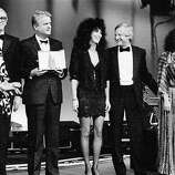 Italian actress Virna Lisi, left,  presents part of the best awards of the 38th Cannes film festival Monday night, May 20, 1985. From left to right are: U.S. actor James Stewart, Yugoslav production Mirza Pasic, U.S. actress Cher, U.S. film director John Boorman and Argentine actress Norma Aleandro.
