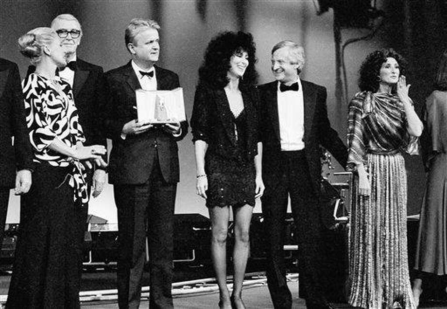Italian actress Virna Lisi, left,  presents part of the best awards of the 38th Cannes film festival Monday night, May 20, 1985. From left to right are: U.S. actor James Stewart, Yugoslav production Mirza Pasic, U.S. actress Cher, U.S. film director John Boorman and Argentine actress Norma Aleandro. Photo: Michel Lipchitz, ASSOCIATED PRESS / AP1985