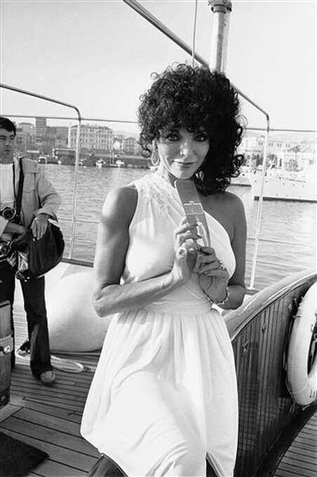 """British actress Joan Collins in Cannes to present """"The Bitch,"""" a Brent Walker film for the 32nd International Film Festival in Cannes on May 13, 1979. Photo:  Jean Jacques Levy, ASSOCIATED PRESS / AP1979"""