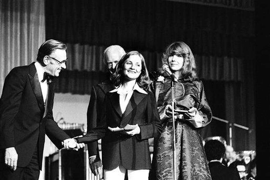 """Festival awards distribution at the 31st Cannes Film Festival, May 30, 1978. Canadian actress Carole Laure and U.S. actor William Holden handing the """"best actor"""" award for U.S. actor John Voight for the film """"Coming Home"""", by Hal Ashby. Photo: AP / 1978 AP"""
