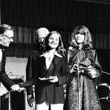 "Festival awards distribution at the 31st Cannes Film Festival, May 30, 1978. Canadian actress Carole Laure and U.S. actor William Holden handing the ""best actor"" award for U.S. actor John Voight for the film ""Coming Home"", by Hal Ashby."