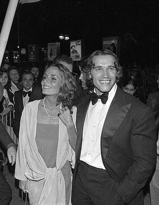 """Arnold Schwarzenegger arrives with his companion at the Cannes Film Festival to present his bodybuilding film """"Pumping Iron"""" in Cannes, France, May 16, 1977. Photo: ASSOCIATED PRESS / AP1977"""