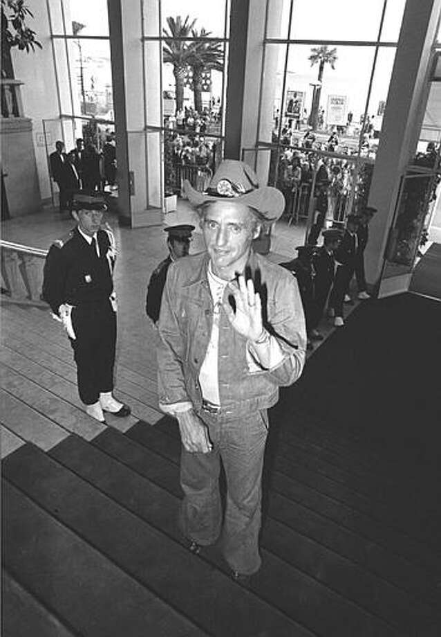 """American director-actor Dennis Hopper arrives at the Festival Palace to present """"Tracks"""" at Cannes International Film Festival in Cannes, France, May 17, 1976. Photo: AP / 1976 AP"""