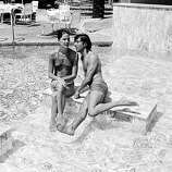"Actor Dustin Hoffman and his wife, ballerina Anne Byrne, enjoy the swimming pool at their hotel in Cannes, France, where the actor is to present his motion picture ""Lenny"" as the American entry at the Cannes Film Festival, on May 15, 1975."