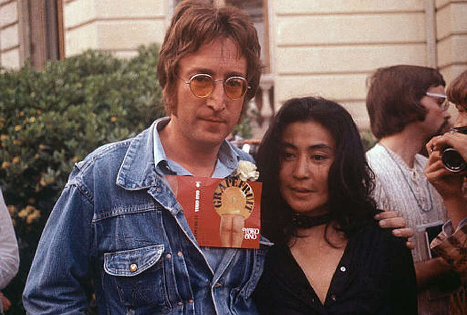 """John Lennon and his wife Yoko Ono are seen at the Cannes Film Festival, May 18, 1971.  Lennon carries Ono's art book """"Grapefruit"""" in his jacket. Photo: MICHEL LIPCHITZ, ASSOCIATED PRESS / AP1971"""