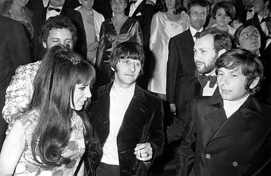 "Beatle drummer Ringo Starr, center, arrives with his wife, Maureen, and director Roman Polanski, far right, at the Festival Palace in Cannes, France, on May 15, 1968.  They are attending the screening of the British entry ""Joanna"" in the Cannes International Film Festival. Photo: RAOUL FORNEZZA, ASSOCIATED PRESS / AP1968"
