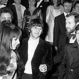 "Beatle drummer Ringo Starr, center, arrives with his wife, Maureen, and director Roman Polanski, far right, at the Festival Palace in Cannes, France, on May 15, 1968.  They are attending the screening of the British entry ""Joanna"" in the Cannes International Film Festival."
