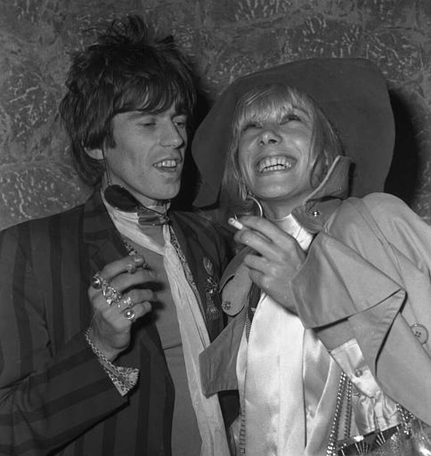 """Keith Richards, guitarist of the Rock Band """"The Rolling Stones"""", left, is pictured with his girlfriend West German actress Anita Pallenberg, at a party given during the International Film Festival in Cannes, France, May 1, 1967. Photo: LEVY, ASSOCIATED PRESS / AP1967"""
