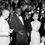 "Actor Sidney Poitier appears at the Cannes Film Festival, Cannes, France, for the showing of his film ""A Raisin in the Sun,"" May 13, 1961.  At right is actress Jean Seberg."