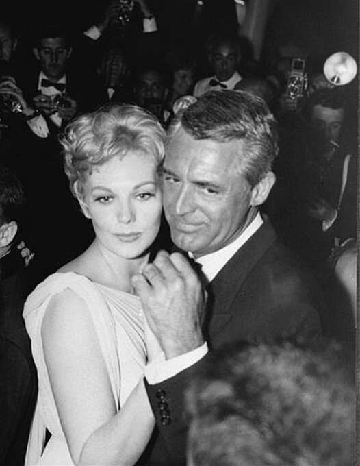 """American actress Kim Novak dances with Cary Grant after the presentation of the American film entry """"Middle of the Night"""", in which Novak starred with Frederic March, at a U.S. reception for the Cannes Film Festival May 13, 1959. Photo: AP / 1959 AP"""