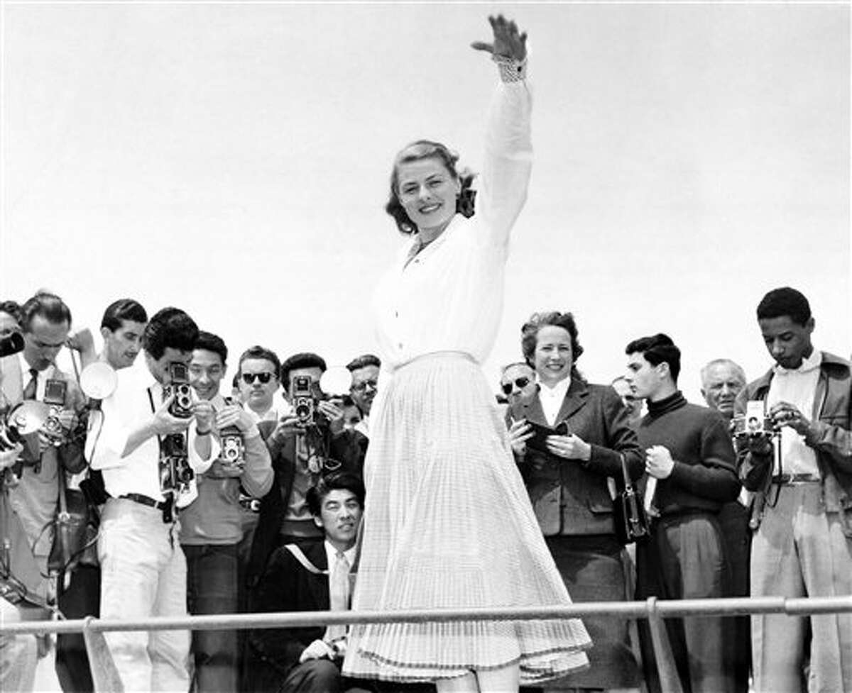 Ingrid Bergman is snapped from all sides by a crowd of photographers at Cannes, May 16, 1956. She was one of the attractions at the film festival on the Riviera.