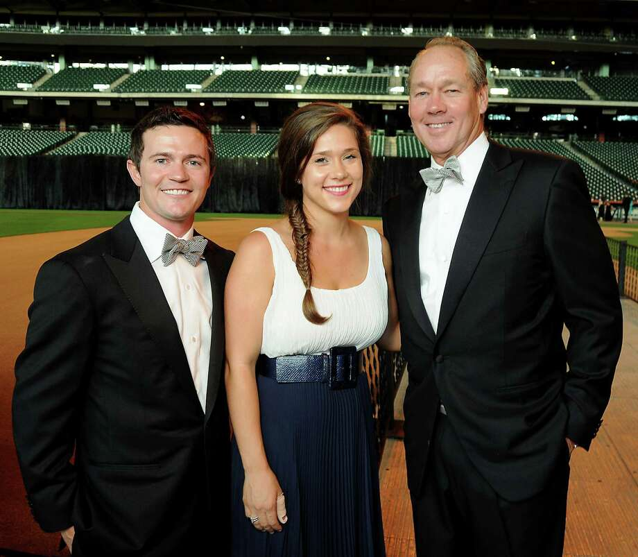 2012Garrett and Krystal Thompson stand next to her father, Astros owner Jim Crane, at the Astros Wives' Gala at Minute Maid Park. Photo: Dave Rossman, For The Houston Chronicle / © 2012 Dave Rossman