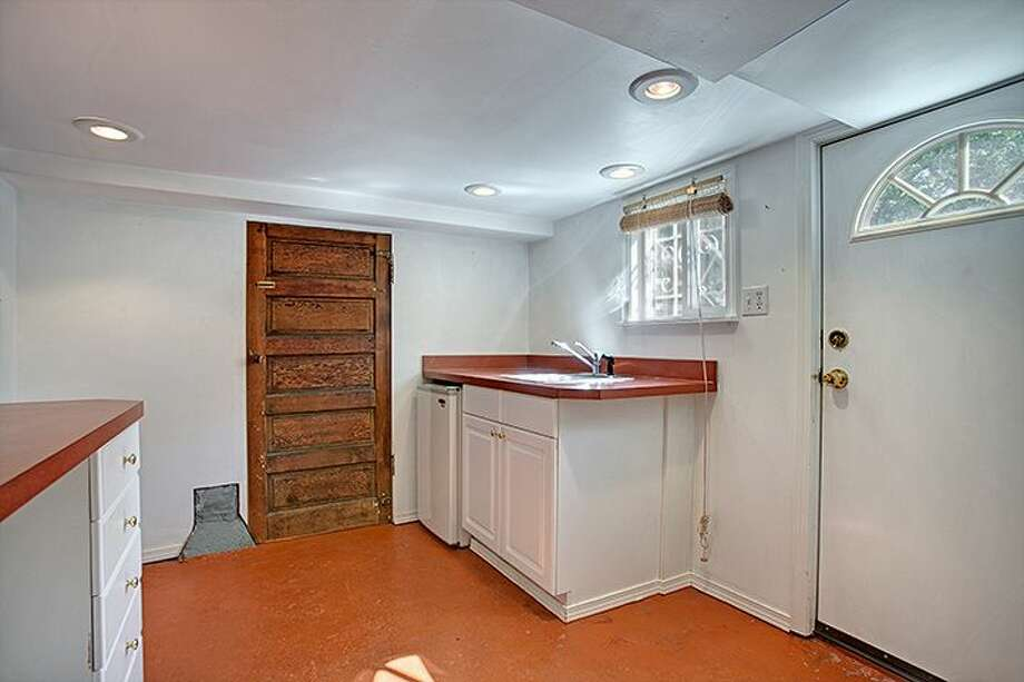 Non-conforming basement apartment kitchen of 1610 S. Hill St. The 1,960-square-foot Craftsman, built in 1912, has three bedrooms, 1.75 bathrooms, an office, a front porch and a patio on a 2,000-square-foot lot. It's listed for $299,950, although a sale is pending. Photo: Courtesy Jackie Leone Pleasant, Windermere Real Estate