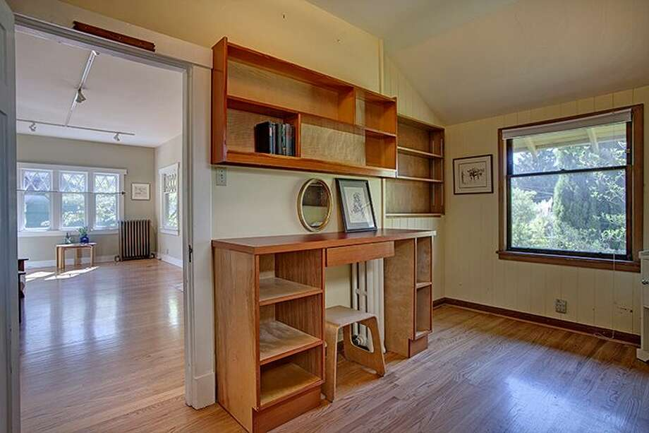 Office of 1610 S. Hill St. The 1,960-square-foot Craftsman, built in 1912, has three bedrooms, 1.75 bathrooms, a non-conforming basement apartment, a front porch and a patio on a 2,000-square-foot lot. It's listed for $299,950, although a sale is pending. Photo: Courtesy Jackie Leone Pleasant, Windermere Real Estate
