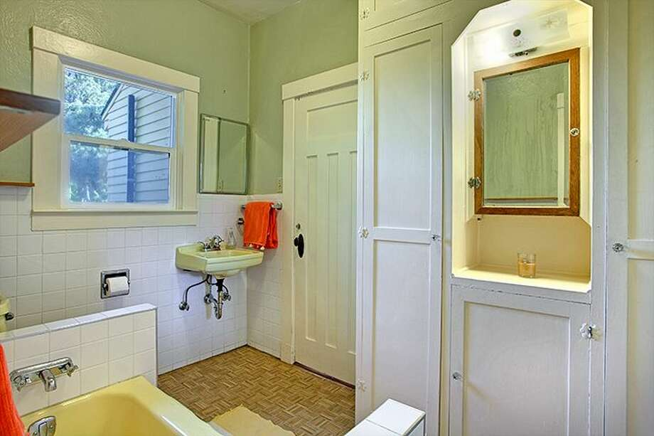 Bathroom of 1610 S. Hill St. The 1,960-square-foot Craftsman, built in 1912, has three bedrooms, 1.75 bathrooms, an office, a non-conforming basement apartment, a front porch and a patio on a 2,000-square-foot lot. It's listed for $299,950, although a sale is pending. Photo: Courtesy Jackie Leone Pleasant, Windermere Real Estate
