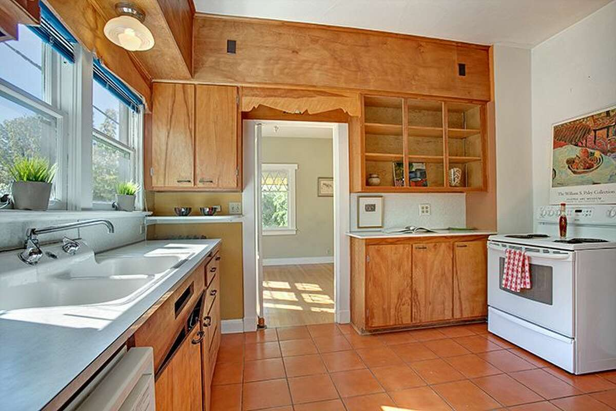 Kitchen of 1610 S. Hill St. The 1,960-square-foot Craftsman, built in 1912, has three bedrooms, 1.75 bathrooms, an office, a non-conforming basement apartment, a front porch and a patio on a 2,000-square-foot lot. It's listed for $299,950, although a sale is pending.
