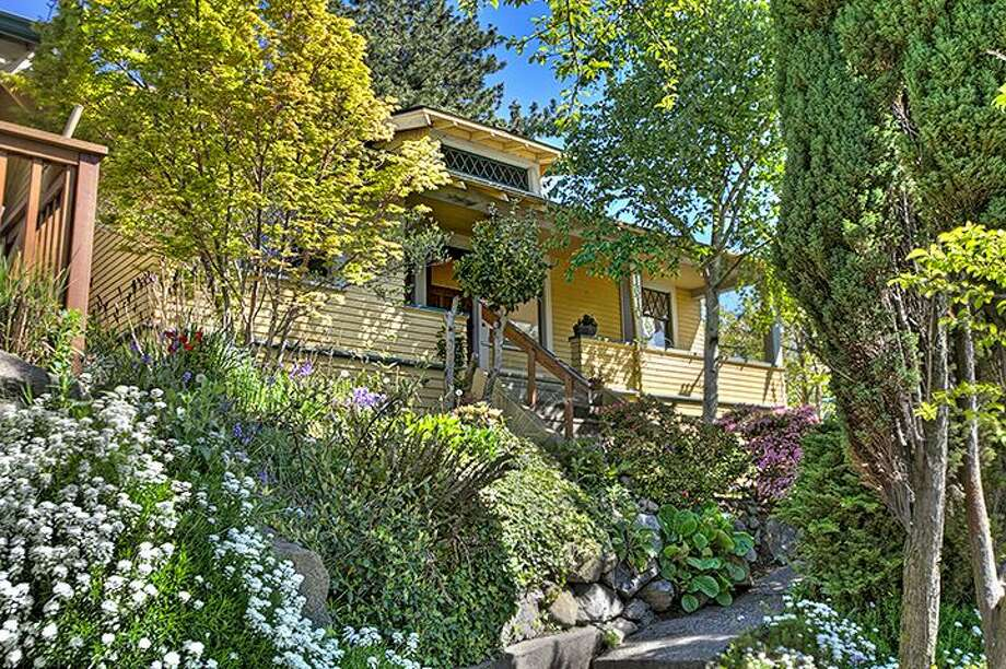 Beacon Hill offers nice, affordable homes, by Seattle standards, convenient to downtown Seattle. Here are four listed there for $299,900 to $349,900, starting at the low end, with 1610 S. Hill St. The 1,960-square-foot Craftsman, built in 1912, has three bedrooms, 1.75 bathrooms, an office, a non-conforming basement apartment, a front porch and a patio on a 2,000-square-foot lot. It's listed for $299,950, although a sale is pending. Photo: Courtesy Jackie Leone Pleasant,  Windermere Real Estate