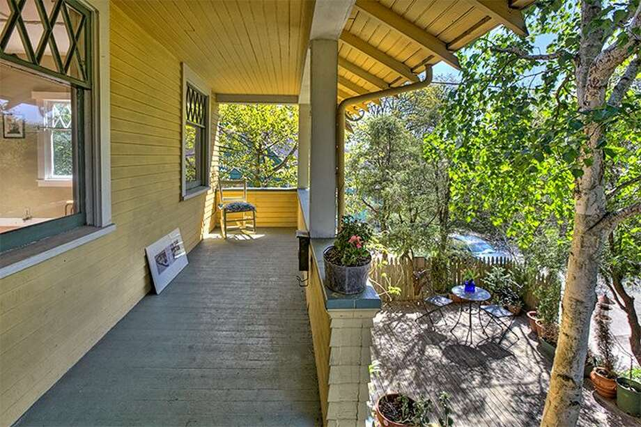 Front porch of 1610 S. Hill St. The 1,960-square-foot Craftsman, built in 1912, has three bedrooms, 1.75 bathrooms, an office, a non-conforming basement apartment and a patio on a 2,000-square-foot lot. It's listed for $299,950, although a sale is pending. Photo: Courtesy Jackie Leone Pleasant, Windermere Real Estate