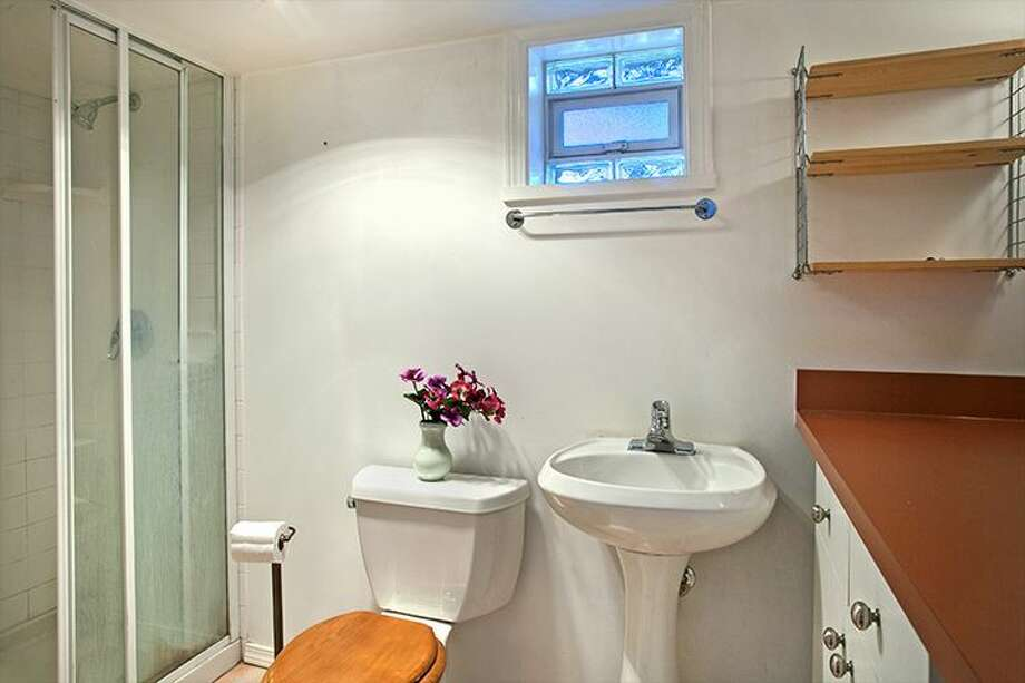 Non-conforming basement apartment bathroom of 1610 S. Hill St. The 1,960-square-foot Craftsman, built in 1912, has three bedrooms, 1.75 bathrooms, an office, a front porch and a patio on a 2,000-square-foot lot. It's listed for $299,950, although a sale is pending. Photo: Courtesy Jackie Leone Pleasant, Windermere Real Estate