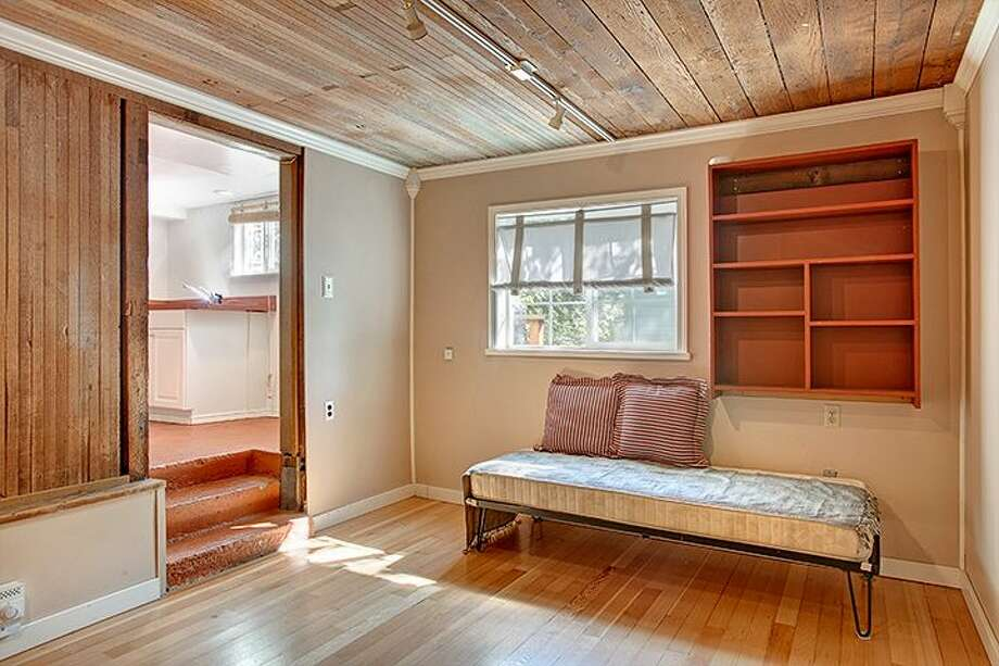 Non-conforming basement apartment of 1610 S. Hill St. The 1,960-square-foot Craftsman, built in 1912, has three bedrooms, 1.75 bathrooms, an office, a front porch and a patio on a 2,000-square-foot lot. It's listed for $299,950, although a sale is pending. Photo: Courtesy Jackie Leone Pleasant, Windermere Real Estate