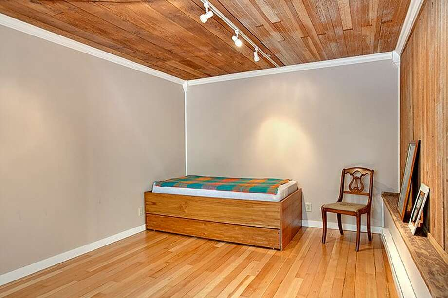 Non-conforming basement apartment bedroom of 1610 S. Hill St. The 1,960-square-foot Craftsman, built in 1912, has three bedrooms, 1.75 bathrooms, an office, a front porch and a patio on a 2,000-square-foot lot. It's listed for $299,950, although a sale is pending. Photo: Courtesy Jackie Leone Pleasant, Windermere Real Estate
