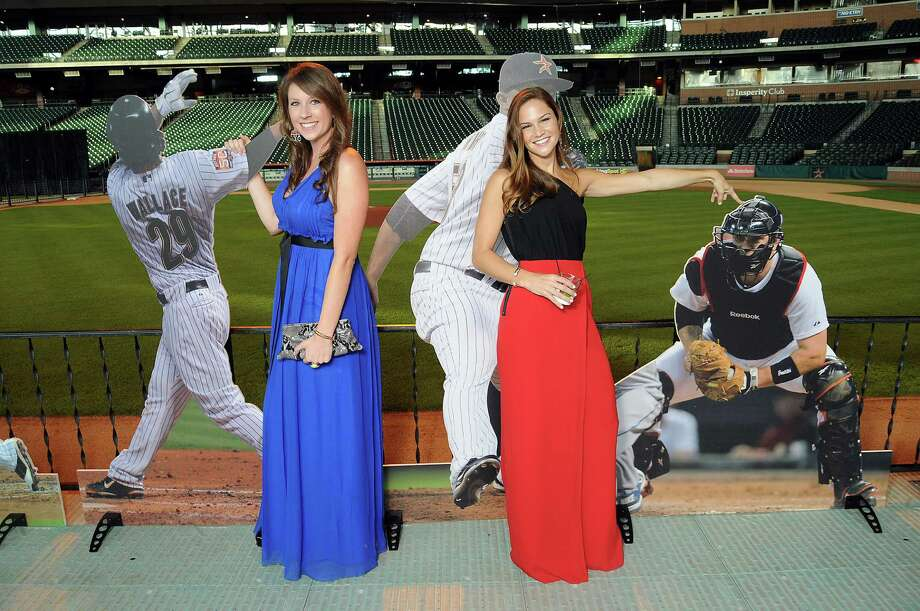 Taylar Sullivan, left, and Maris Perlman pose with cut-outs of their boyfriends, first baseman Brett Wallace and catcher Jason Castro, respectively, at the Astros Wives' Gala. Photo: Dave Rossman, For The Houston Chronicle / © 2012 Dave Rossman