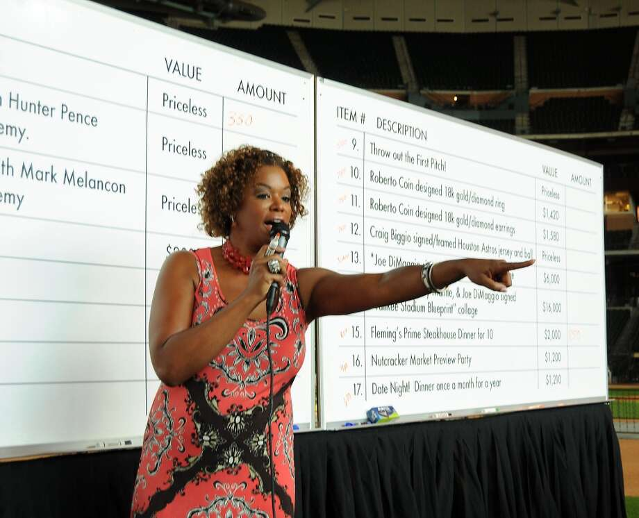 Deborah Duncan works the auction at the Astros Wives Gala at Minute Maid Park.