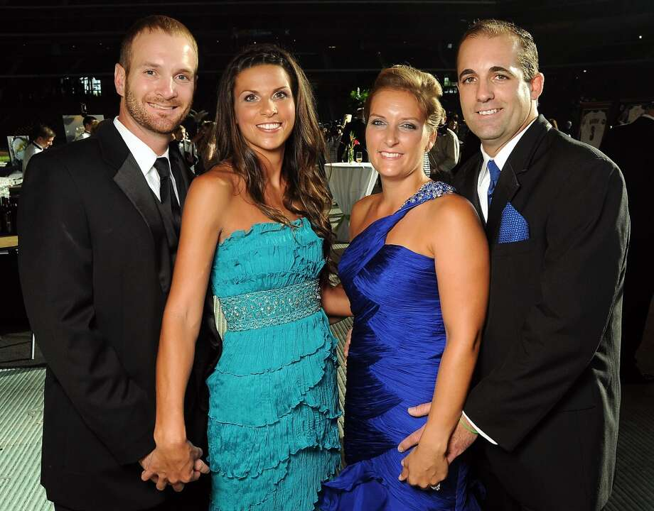 From left: Jeff and Morgan Keppinger with Heather and Tim Byrdak at the annual Astros Wives Gala at Minute Maid Park .