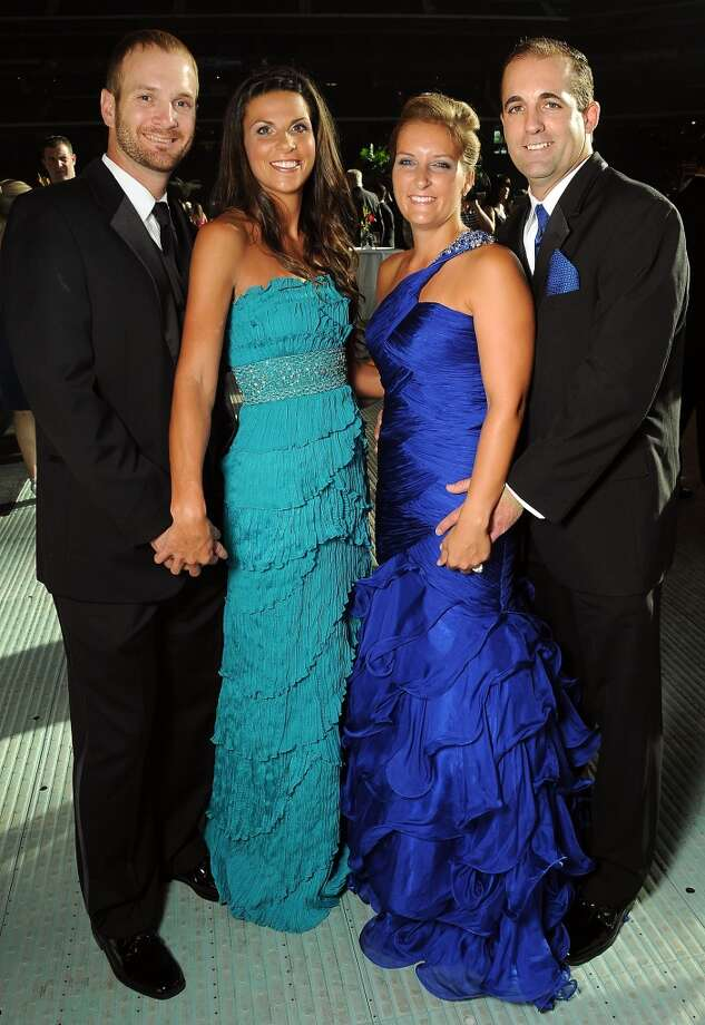 From left: Jeff and Morgan Keppinger with Heather and Tim Byrdak at the annual Astros Wives Gala at Minute Maid Park.