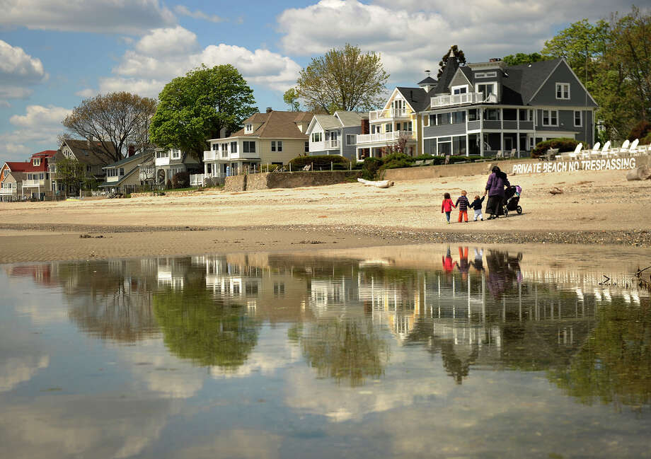 Shorefront homes and billowy clouds are reflected in a tidal pool at the beach in the Fort Trumbull section of Milford, Conn. on Tuesday, May 14, 2013. Photo: Brian A. Pounds / Connecticut Post