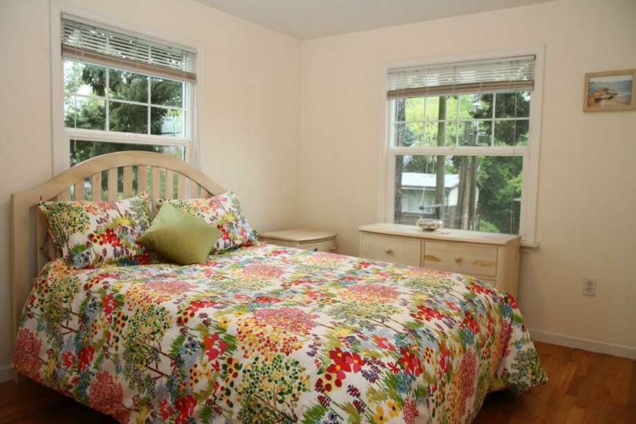 Bedroom of 4516 10th Ave. S. The 1,540-square-foot house, built in 1941, has two bedrooms, one bathroom, a rec room, French doors and a back deck on a 4,304-square-foot lot. It's listed for $299,950. Photo: Susan Torrey, Coldwell Banker Danforth