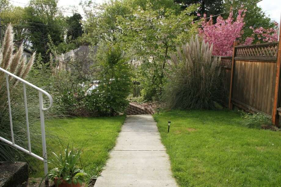 Yard of 4516 10th Ave. S. The 1,540-square-foot house, built in 1941, has two bedrooms, one bathroom, a rec room, French doors and a back deck on a 4,304-square-foot lot. It's listed for $299,950. Photo: Susan Torrey, Coldwell Banker Danforth