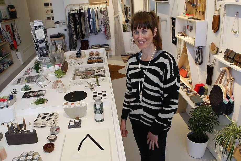 "Kelly Lynn Jones gets her new shop, Little Paper Planes - a brick-and-mortar spin-off of her online business - ready on Valencia Street in San Francisco: ""My concept is gallery meets shop meets living room."" Photo: Liz Hafalia, The Chronicle"