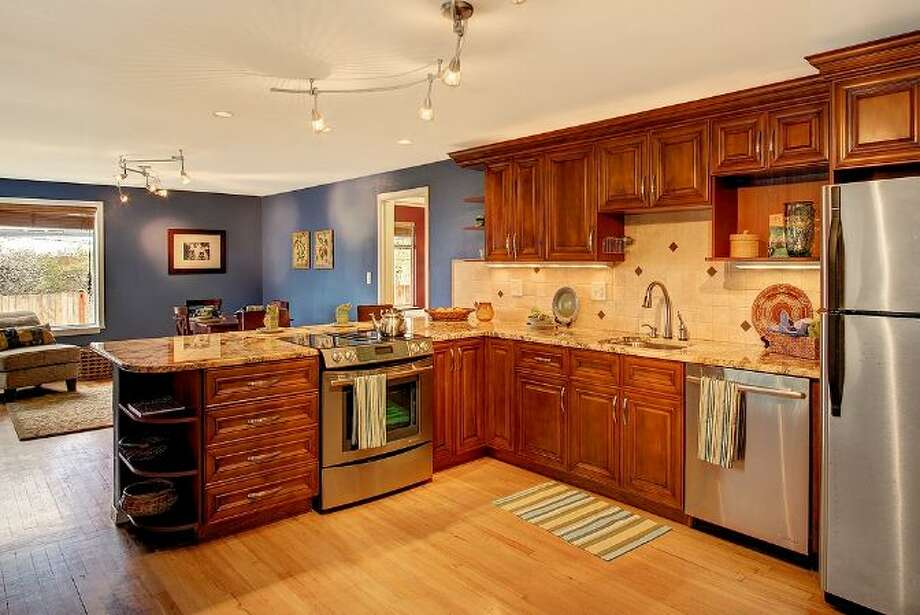 Kitchen of 6208 Gould Ave. S. The 1,840-square-foot rambler, built in 1952, has four bedrooms, 1.75 bathrooms, a sun room, French doors and a back patio on a 5820-square-foot lot. It's listed for $315,000. Photo: Courtesy Heather O'Malley, Windermere Real Estate