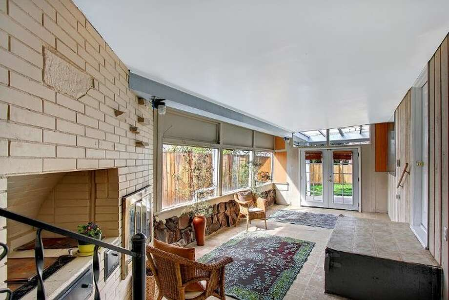 Sun room of 6208 Gould Ave. S. The 1,840-square-foot rambler, built in 1952, has four bedrooms, 1.75 bathrooms, French doors and a back patio on a 5820-square-foot lot. It's listed for $315,000. Photo: Courtesy Heather O'Malley, Windermere Real Estate