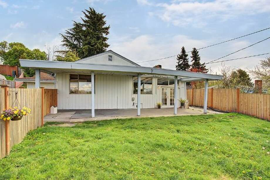 Moving up to $315,000, here's 6208 Gould Ave. S. The 1,840-square-foot rambler, built in 1952, has four bedrooms, 1.75 bathrooms, a sun room, French doors and a back patio on a 5820-square-foot lot. Photo: Courtesy Heather O'Malley, Windermere Real Estate