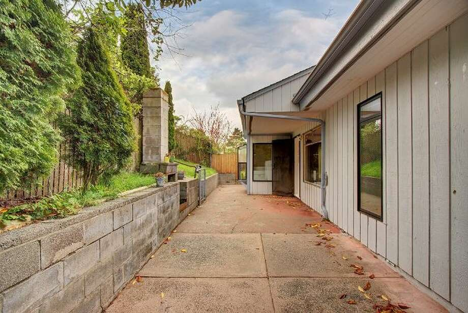 Exterior of 6208 Gould Ave. S. The 1,840-square-foot rambler, built in 1952, has four bedrooms, 1.75 bathrooms, a sun room, French doors and a back patio on a 5820-square-foot lot. It's listed for $315,000. Photo: Courtesy Heather O'Malley, Windermere Real Estate