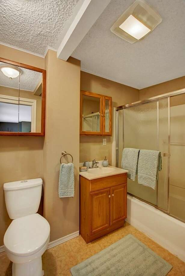 Bathroom of 6208 Gould Ave. S. The 1,840-square-foot rambler, built in 1952, has four bedrooms, 1.75 bathrooms, a sun room, French doors and a back patio on a 5820-square-foot lot. It's listed for $315,000. Photo: Courtesy Heather O'Malley, Windermere Real Estate