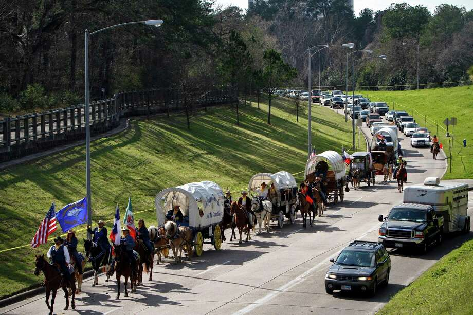 You get stuck behind the trail riders on your way to work because you forgot they were coming to town.  --Michael Paulsen / Houston Chronicle Photo: Michael Paulsen, Chronicle / Houston Chronicle